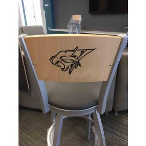 a wooden chair with school mascot on back