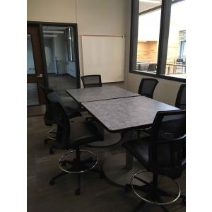 Dim office with table and chairs