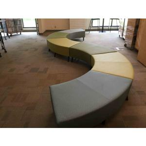 A long curved multicolored couch