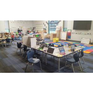 Desk and chairs in classroom